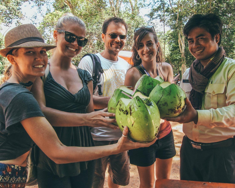 drinking coconuts in angkor wat