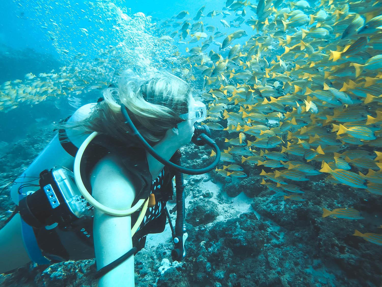 Blonde Girl Scuba Diving with Fish Ocean