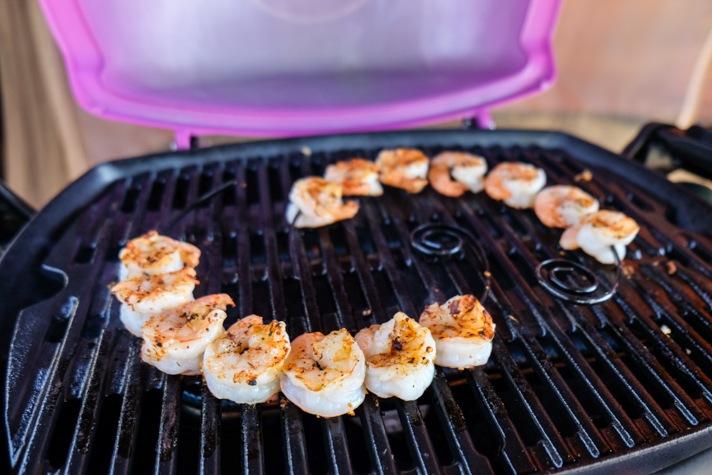 Pink Weber grill and shrimp
