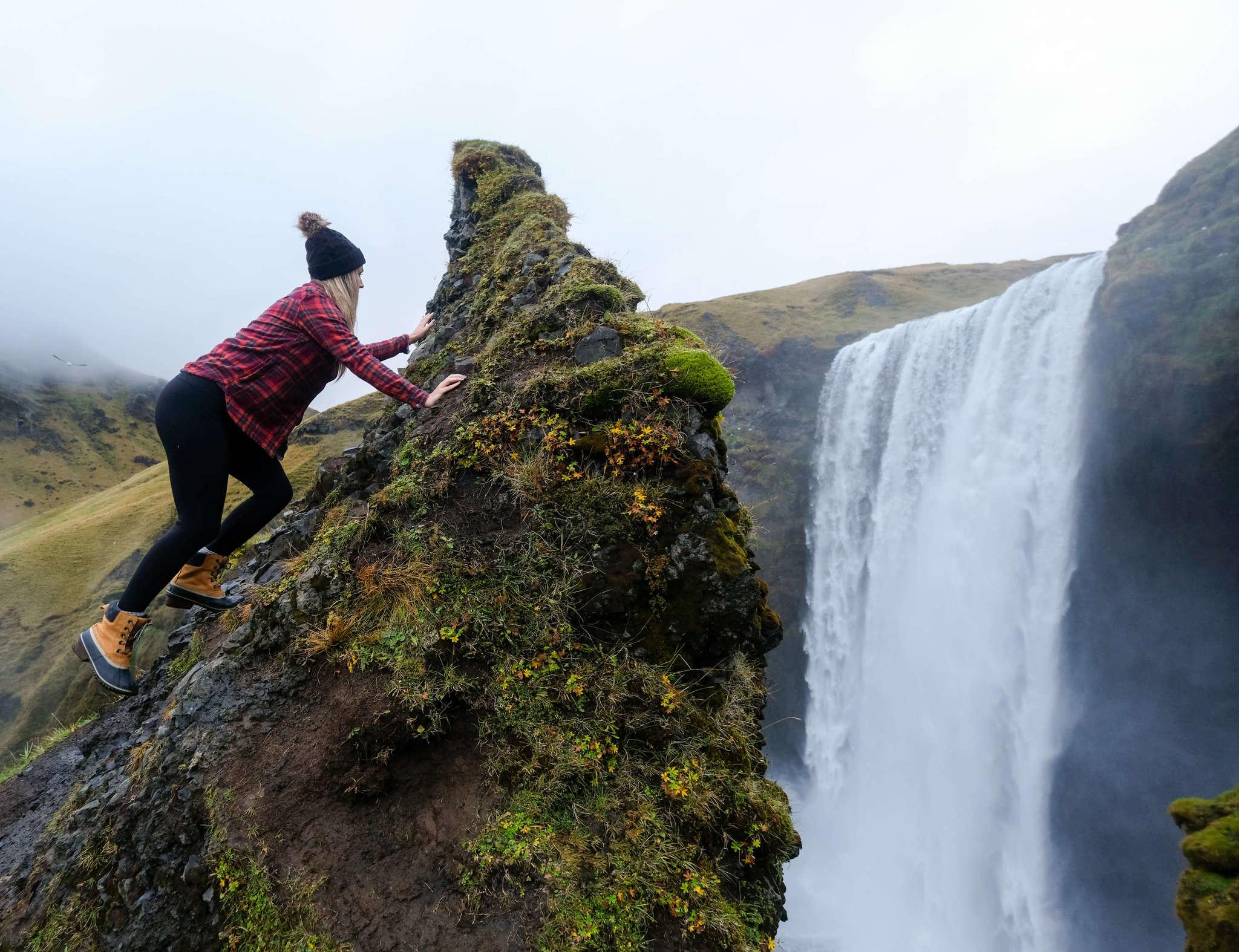 Climbing Skógafoss Waterfall, Iceland