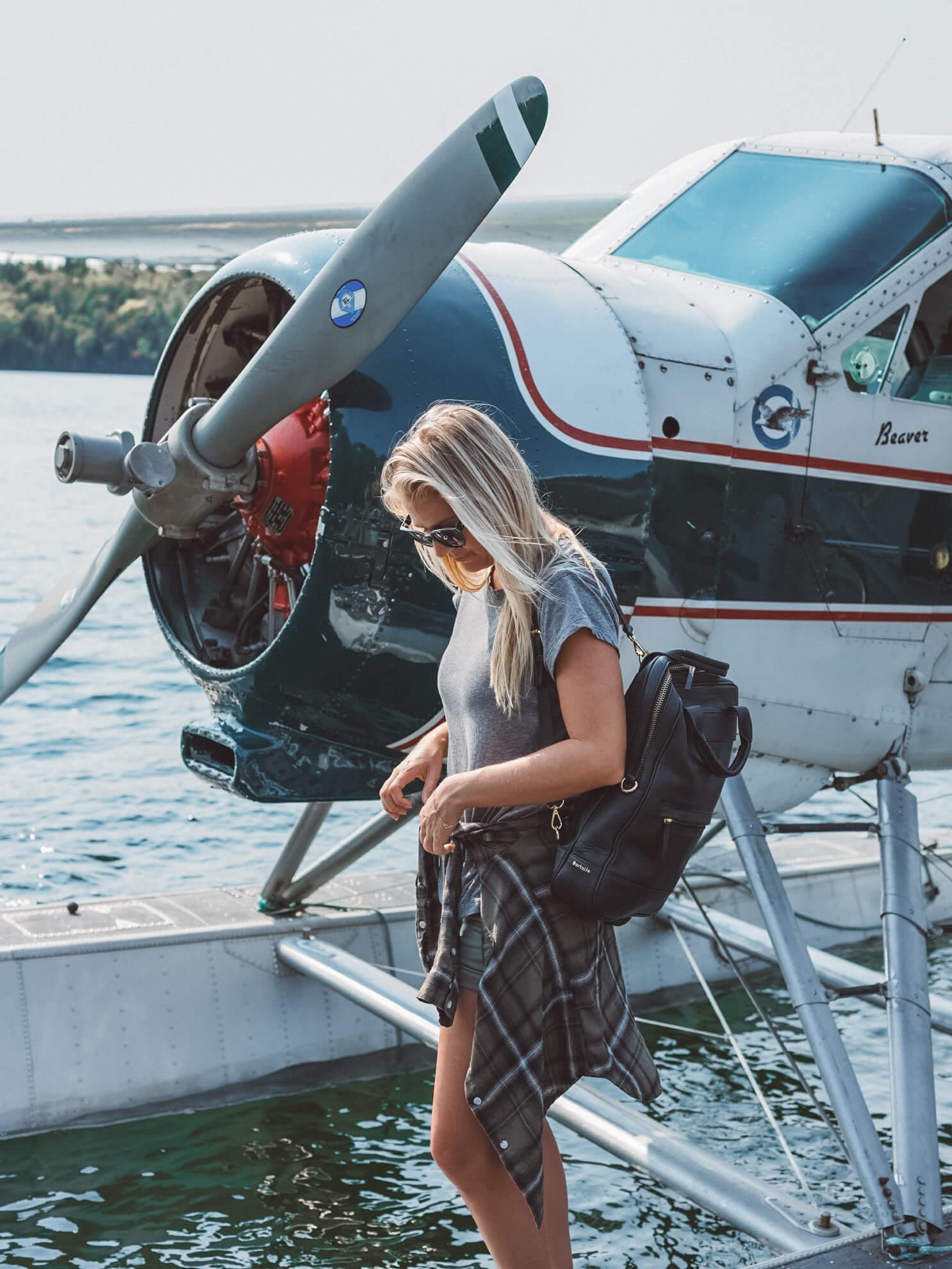 Blonde taking sea plane in Quebéc